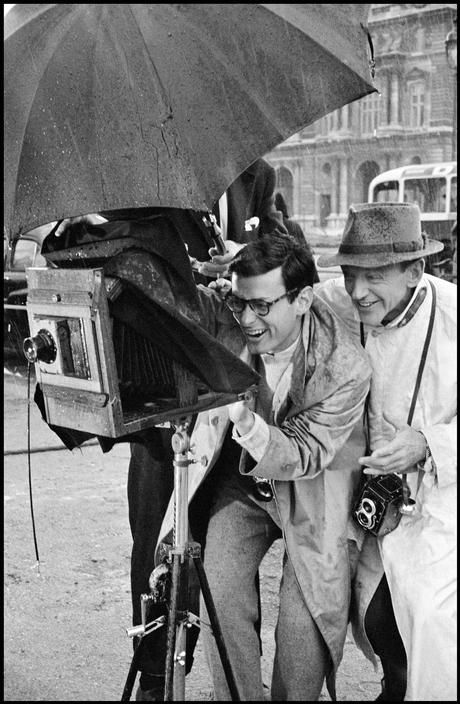 Paris. The Tuileries Gardens. Richard AVEDON, fashion photographer and technical director, advising Fred ASTAIRE