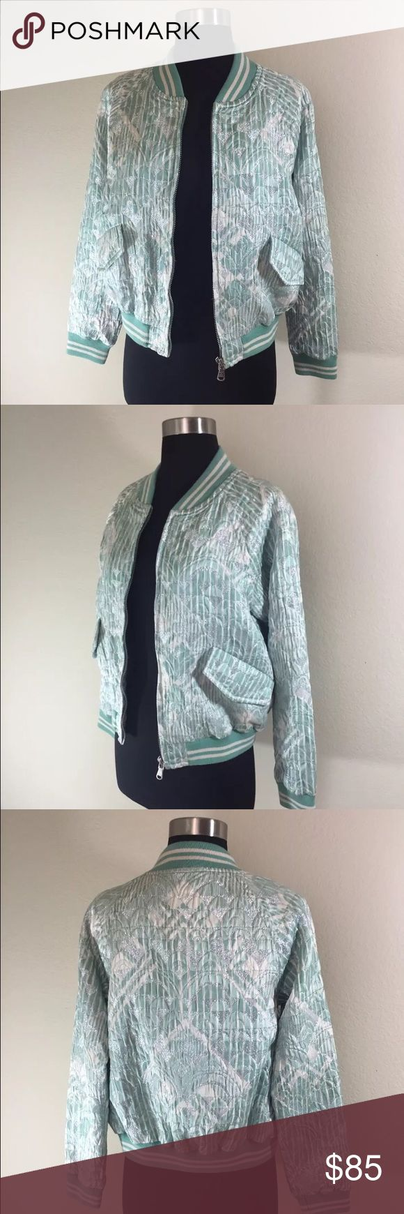 Marc by Marc Jacobs Matelasse Bomber Jacket Mint green and cream floral print with athletic style elastic waistband. Floral print has metallic/silver sheen effect. Silver hardware. Excellent pre-owned condition. Lightly worn. Marc by Marc Jacobs Jackets & Coats