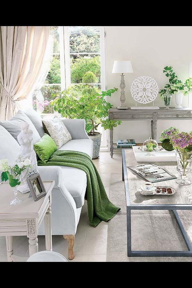 Light gray and green living room design idea white sofa with bright green cushion and throw pantone greenery is the colour of the year