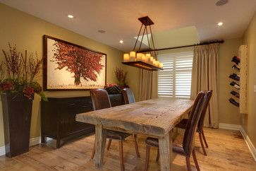 Weathered table with leather parsons chairs. Nice light fixture. Warm colors. Like the tree pic. Buffet behind table.