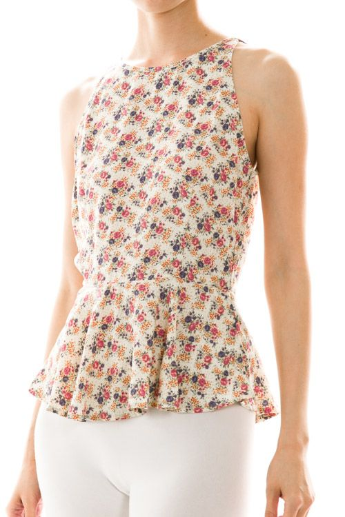 How sweet is this peplum top!? Perfect with jeans. Perfect with a pencil skirt. Perfect under a blazer. Just perfect!