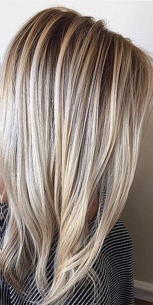 blonde balayage highlights with rooty darker base underneath