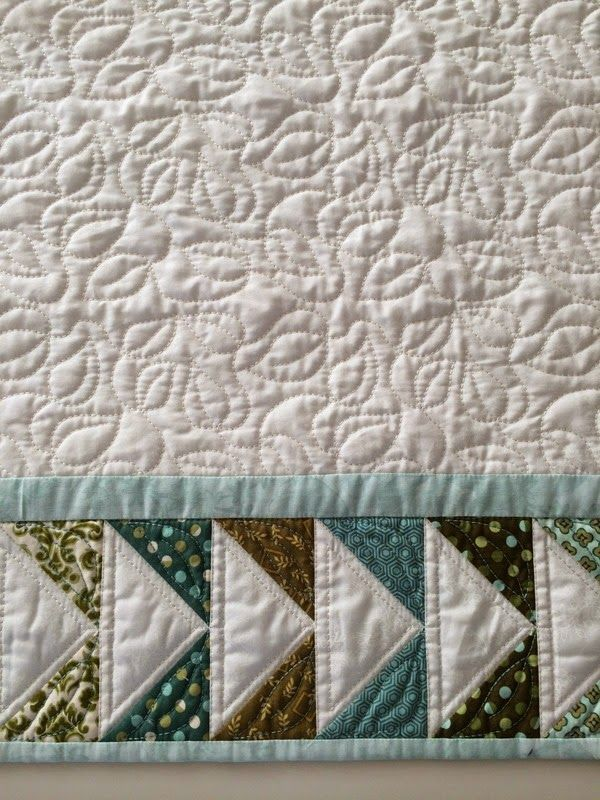 """Part of a tablecloth continous quilted in the """"Metal Hoop"""". The flying geese border is pieced in the hoop. I prefer the Mega Endless Hoop (Husqvarna Viking) or the Grand Endless Hoop (Pfaff) for this kind of piecing."""