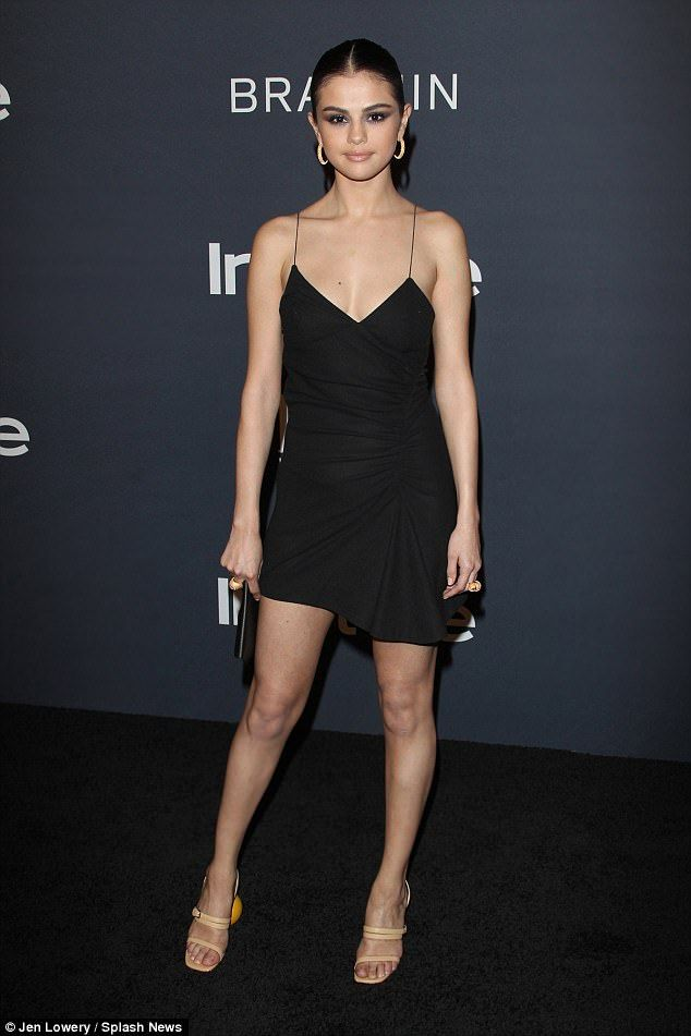 LBD: The pop starlet, who released her new song Wolves on Monday, added a pair of tan sandal heels and carried a small black clutch