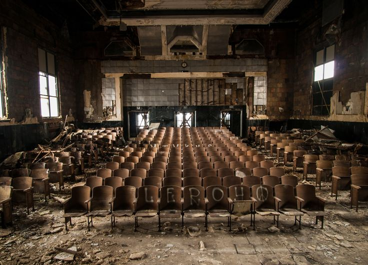 28 Abandoned Structures Still As Vibrant As The Day They Were Deserted | A vast, silent auditorium within a school in Pennsylvania.