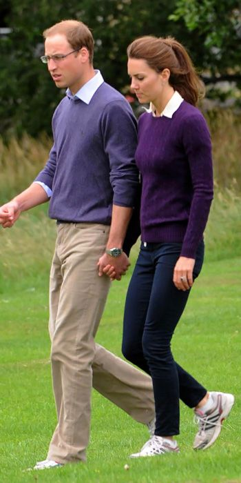 AUGUST 1, 2011 Prince William took a few style tips from his new wife, Duchess Catherine—the couple wore matching sweaters over white collared shirts in Edinburgh's Holyrood Park.