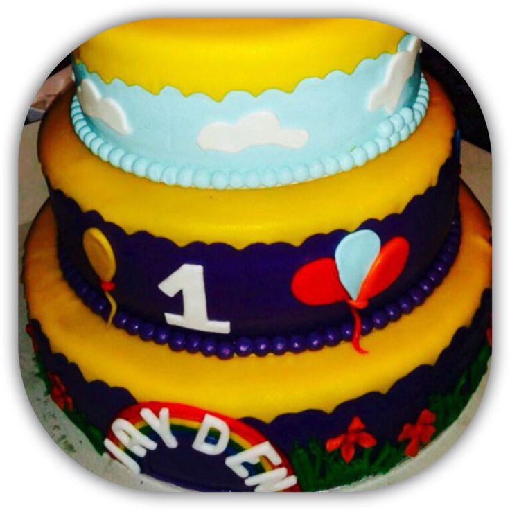 Baby boys' 1st birtday cake - theme: baby tv - tulli.  Fillings - 2 layers 3 tier cake : Tier 1 & 3: swiss cream - cookie cream (bastogne) Tier 2: swiss cream - coconut cream