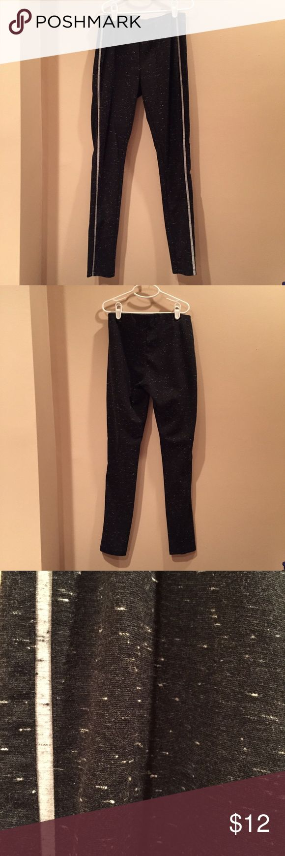 Heathered charcoal leggings (Lou & Grey) Only worn a few times! These are dark charcoal heathered leggings with light grey stripes down the sides of the legs. They have an elastic waist band and fit snug with less stretch than your normal leggings. Originally bought from Loft/Lou & Grey. Lou & Grey Pants Leggings