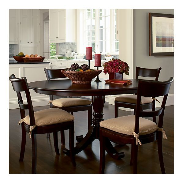 Really like this table from Crate and Barrel. It can be round for 4 or oval for 6 ppl.
