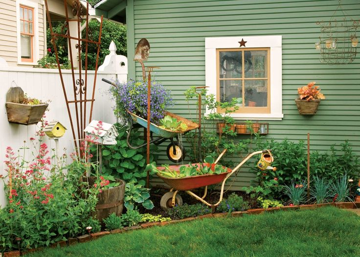 recycle two old wheelbarrows into a charmingly rustic garden fountain