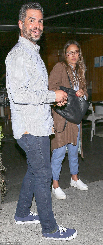 A perfect match! Jessica Alba and husband Cash Warren wore matching shirts while celebrati...