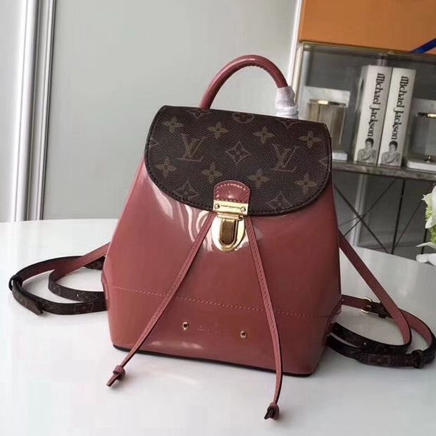 b20ec2414f69 Louis Vuitton Hot Springs Backpack in Monogram Canvas Patent Leather Cameo  2018