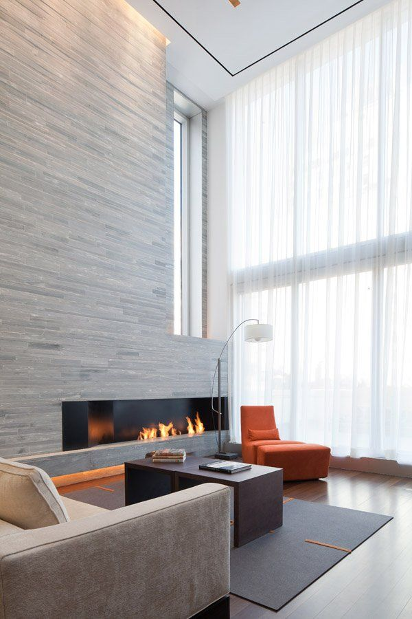 Interior of the 73rd Street Penthouse by Turett Collaborative Architects. Beautiful stone wall.