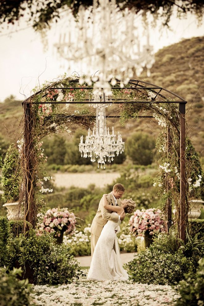 Chandeliers and Outdoor Weddings - Belle the Magazine . The Wedding Blog For The Sophisticated Bride - such a cute idea for a little bit of elegance outside :)