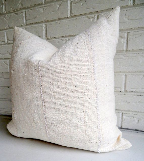 White African Mudcloth Pillow Cover - Cream Earthy Bohemian Accent Pillow - Neutral Pillows  This pillow cover is made from a beautiful hand-woven African mudcloth* from Mali and will make a great neutral accent piece. This heavyweight material is sewn together by hand in strips which are approximately 5-6 wide. The color is a beautiful off white/cream with natural flecking with lots of yummy texture. The backing is your choice of cream or oatmeal colored linen (see last image and dropdo...