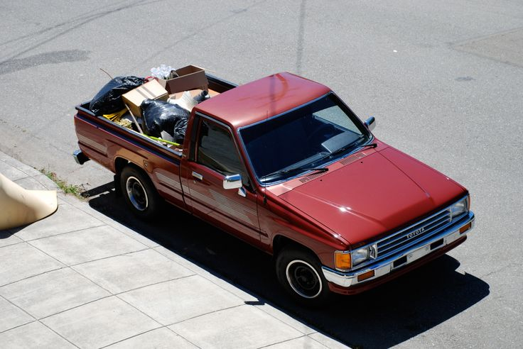 1987 Toyota Pickup hauling a load of trash to the dump in 2008. It now has 260,000 miles and is still running strong. I love its boxy lines and tiny size compared to modern trucks.