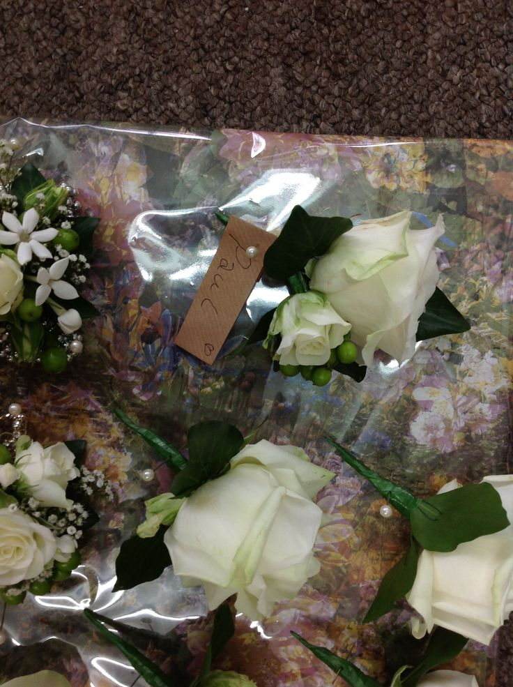The grooms buttonhole with a spray rose, large avalanche rose and hypericum berries - matched the brides bouquet perfectly!