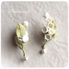「すずらんのイヤーカフ。とってもお気に入りの作品です♡ デザフェスで販売いたします。 #crochet #lilyofthevalley #crochetflower #すずらん #イヤーカフ」