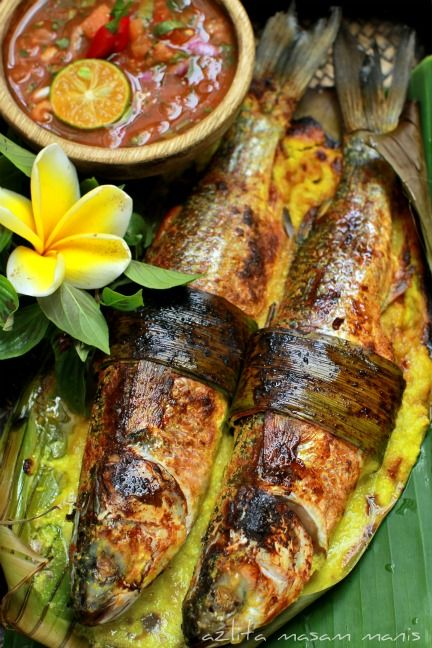 "IKAN BAKAR LEMAK PANDAN (Translating to ""burned fish,"" ikan bakar is the catch-all term for small grilled swimmers. You'll often see it wrapped in a banana leaf before it goes on the grill, so that the leaf gets direct heat contact, rather than the fish itself; it's generally marinated in a blend of turmeric, chilis, belacan, galangal, and those other now-familiar ingredients, and served with sambal.)"