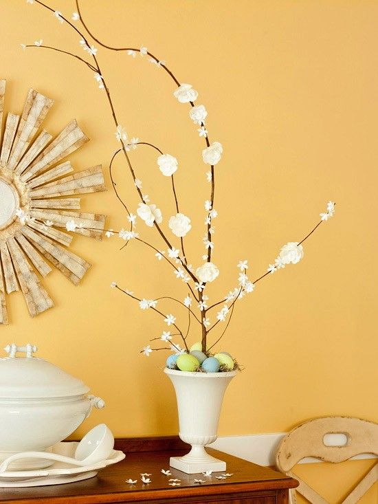 glue silk flowers on twigs in urn and add easter eggs
