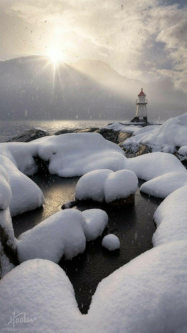 Lighthouse by the fjord in Sunndal, Norway. title Snow Globe