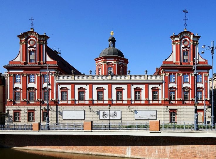 The building of the Ossolineum in Wrocław was originally a medieval convent of the Knights of the Cross with the Red Star, which was rebuilt in baroque style by Jean Baptiste Mathey and Simon Wiedemann between 1690-1704 for abbot Johann Chrysostom Neborak