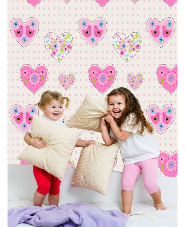 Decorate your child's bedroom with this stunning Hearts and Birds Wallpaper. The pretty design features colourful patterned hearts with birds and flowers in pink, green and blue, on a pale cream background decorated with pink flowers and infused with a subtle pearlescent shimmer.