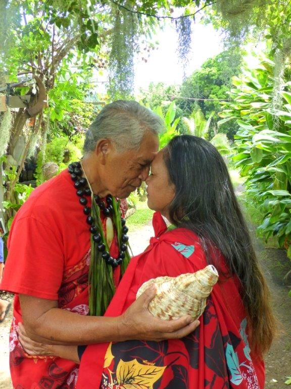 The traditional honi Polynesian greeting, pressing foreheads and noses together and breathing in each other's life essence. The breath of life.
