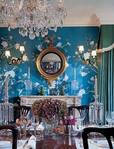 Greg Jordan From Architectural Digest, a beautiful traditional dining room but with a jolt of color from the hand painted teal blue Chinoiserie wallpaper.