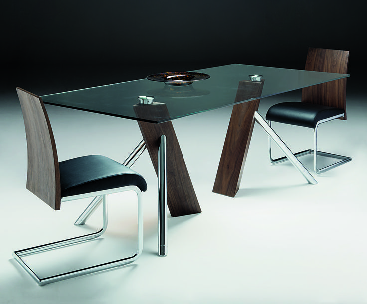 Relax Dining Table - angled stainless steel and walnut bases with glass tops