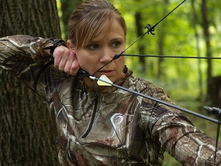 On target. Nice focus with the bow and  RealTree.  Women hunt too.