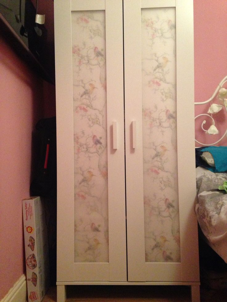 Spare wallpaper left after decorating so decided to put it on the inside of an ANEBODA wardrobe from Ikea, looks effective