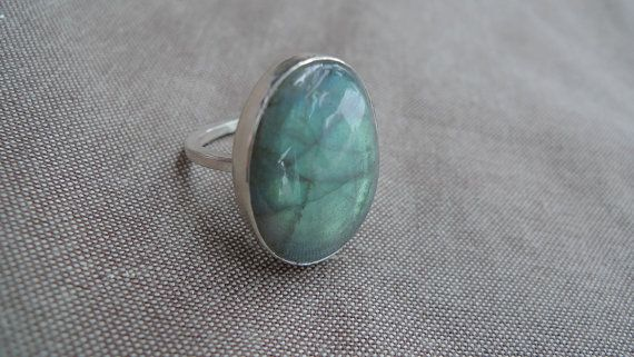 Labradorite Oval Lost & Found Stacking Ring.  This ring features a large oval labradorite stone, set in a bezel setting. The way the light plays off of this stone is truly amazing and iridescent.