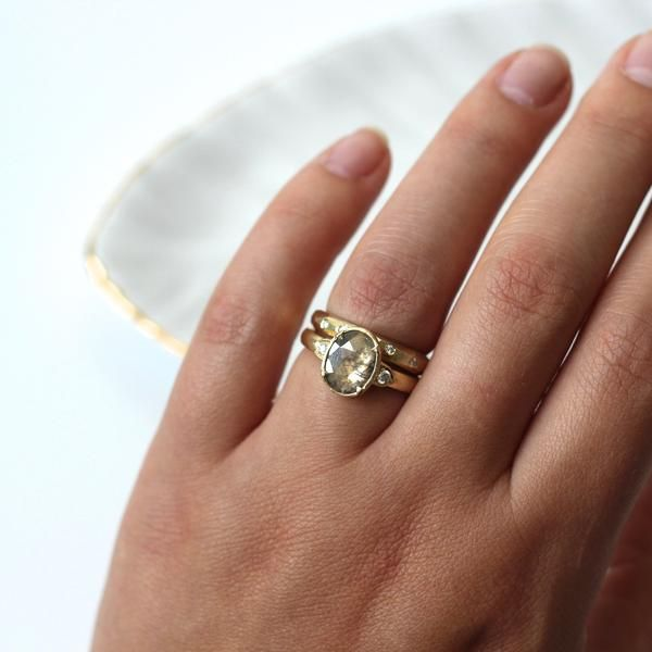 Faceted band in solid 14k yellow gold with 5 small brilliant cut diamonds scattered around the facets. Alternative wedding band.