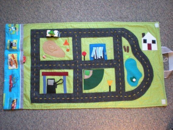 Cars and Trucks Activity Mat (road blanket with car storage). $65.00, via Etsy.