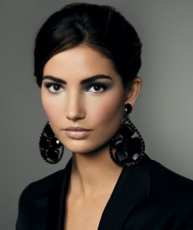I like the way this accents her dark eyes. also doesn't look too unnatural.  the earrings are a nice touch as well, since her hair is either short or pulled back.