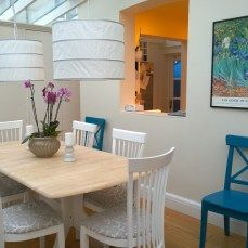 sand and repaint your old dining table and chairs, in white an teal blue to create a fresh and Mediterranean feel
