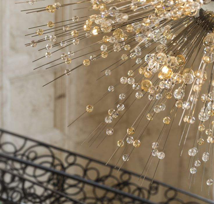 Four Seasons Resort Orlando at Walt Disney World in Florida, USA, features a playful 6-meter fixture inspired by fireworks. Made from hand-blown crystal glass and trimmings, the colours range from clear to light smoky and topaz tones. In collaboration with Anderson Miller. #design #light #lighting #crystal #chandelier #elegance #hotel #hospitality #inspiration