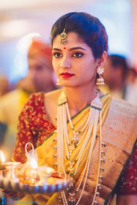 South Indian Bride - Prajwal & Krutika wedding story | Bride in a Red and Gold Kanjivaram Saree with a Pearl Satlada Necklace |WedMeGood #wedmegood #indianbride #indianwedding #bridalwear #satlada #necklace #kanjivaramsaree #gold #marsala