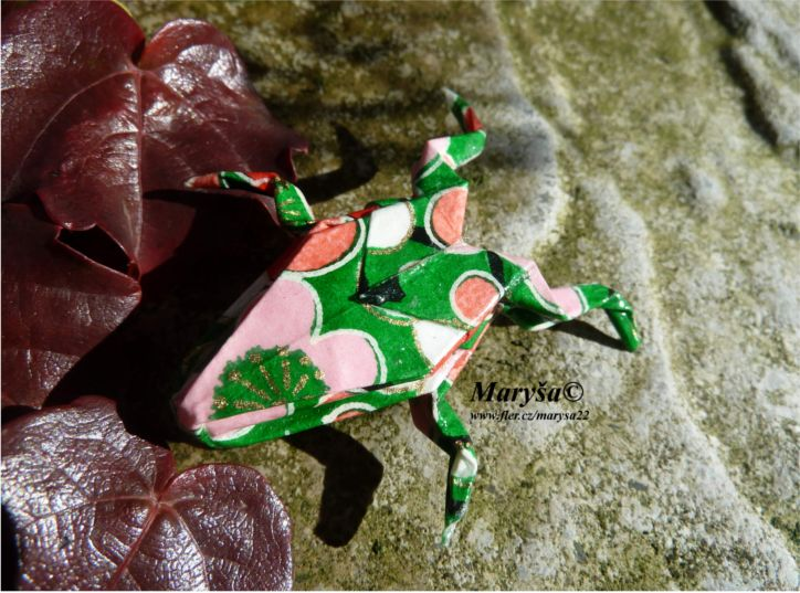 Green origami frog.