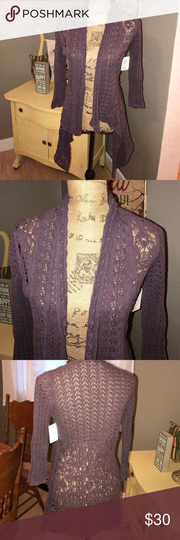 Stunning Cardigan sweater from Cabi Love this!! Dusky purple sz small crocheted type open Cardigan from Cabi in small. Shows no sign of heavy wear. Shark bite type bottom. High quality piece. I have lots more in my closet so ✔️them out to save 💰on bundles. I 💕reasonable offers. CAbi Sweaters Cardigans