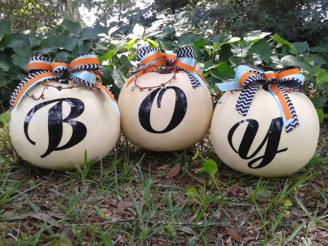 Pumpkins for Baby boy shower or fall decoration. White pumpkins are from Walmart. The 3 colors of ribbon from Hobby Lobby. Beaded vine from Hobby Lobby from forest animal birthday decorations. After the baby shower you  could change the y to an  o to spell BOO for Halloween.