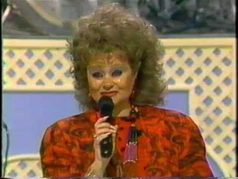 "Tammy Faye Baker sings ""My God is Real"" ... and inbred hillbillies just eat this shit up! Seriously!"