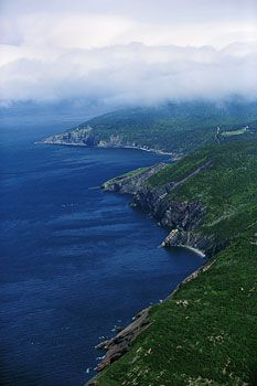 Cape Breton Highlands  The Cabot Trail, Nova Scotia   Cape Breton's northern highlands feature steep cliffs and densely forested plateaus overlooking the Atlantic.   Photo by George Fischer   Excerpted from Unforgettable Canada: 100 Destinations   11