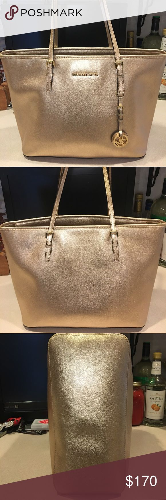 Rare Michael Kors Jet Set Top-Zip Metallic Tote Authentic MK bag in good condition! It has a working zipper on the top for protection. The inside for the most part is clean except for some very small stains (pictured). No stains on the outside of the bag but there is some wear on the straps and on the top and bottom edges of the bag (pictured: you can see the yellow coming through). The pictures really expose the yellow but in person you can't really see it at all. Besides those flaws this…