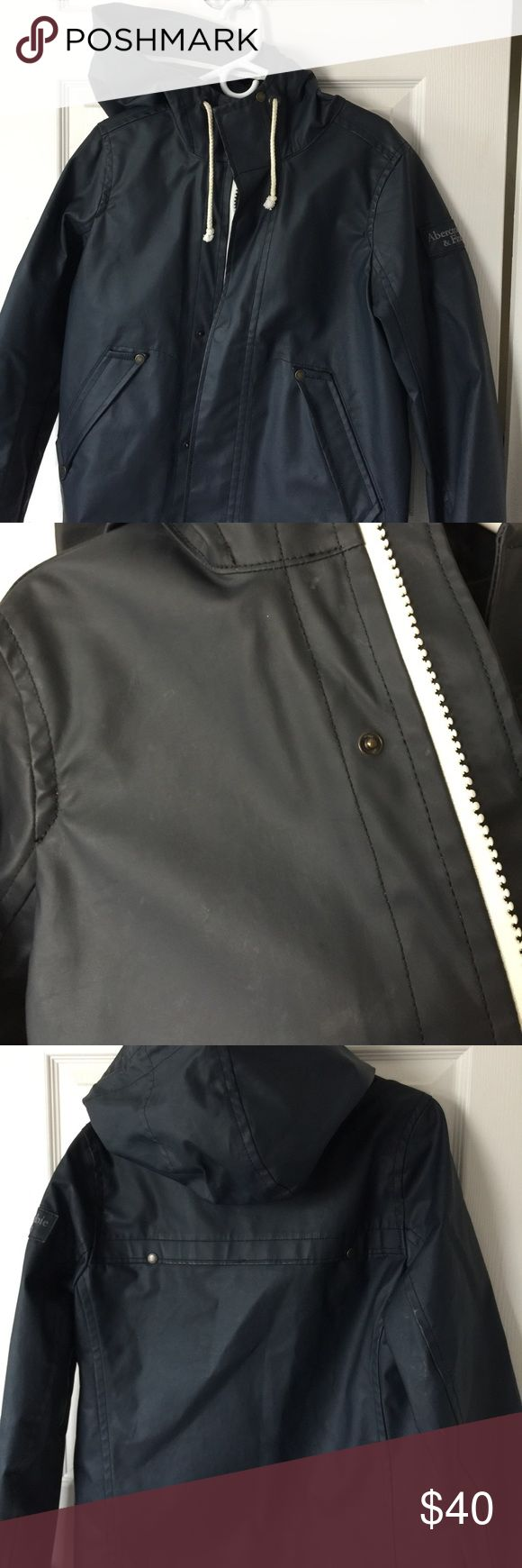 Men's Rain Jacket Abercrombie & Fitch Great rain jacket. Has been outgrown. Worn but still in very good condition. Some discoloration as pictured and staining on the front as pictured. Jacket is navy blue. Kept in a smoke/pet free household. Abercrombie & Fitch Jackets & Coats Raincoats