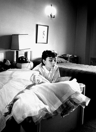Audrey Hepburn reading letters at her hotel, 1953 Archival Prints Available At: www.willoughbyphotos.com
