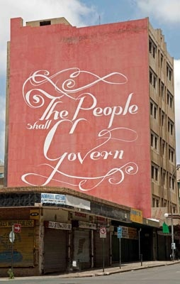 'The People Shall Govern' is an older Faith 47 work appearing on the side of a building in Market Street. This mural featured with other works by Faith in a vimeo titled 'The Freedom Charter' produced by Rowan Pybus of Makhulu Productions. It's a powerful statement of street art as social commentary.