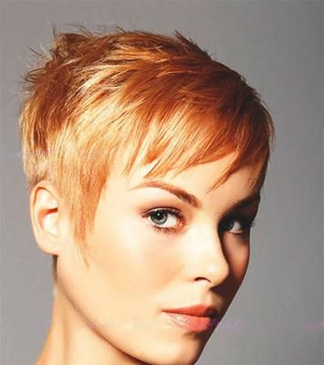 I love this bright honey strawberry blonde and it looks fresh and lovely on this pixie haircut. Face hugging sides with longer strands layered on top for