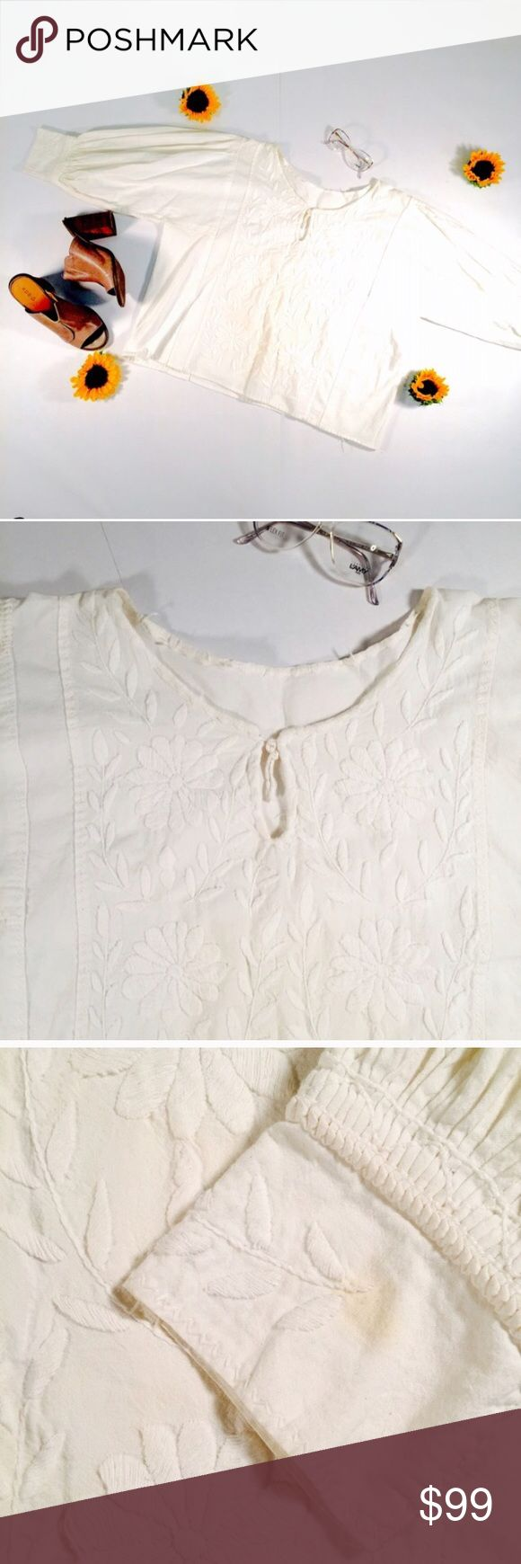 """VINTAGE CREAM EMBROIDERED BOXY PULLOVER TOP WHITE Incredible embroidered 1960s (or earlier) smock, authentic vintage, incredible workmanship. Oversized fit perfect with jeans and ankle boots. Handmade.          CONDITION: EUC, has one yellow discoloration on the left cuff of the top (may come out with treatment)  CHEST: 50"""" WAIST: open  LENGTH: 23.5"""" INSEAM: *All measurements taken while item is laid flat (doubled when necessary) and measured across the front  MATERIAL: Unknown, feels like…"""